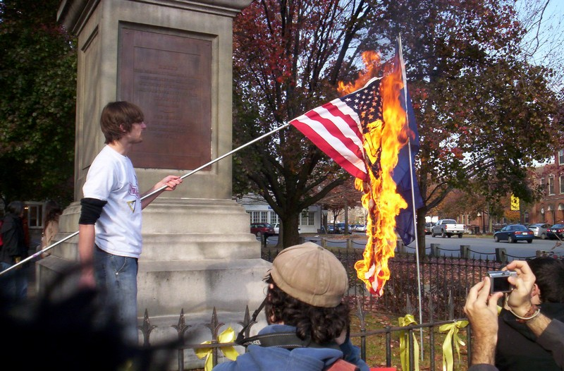flag burning Rep maxine waters (d-ca) claimed the counter-protesters who burned an american flag outside her office advanced their own agendas.