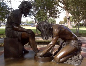 washing feet sculpture