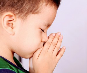 little boy in prayer